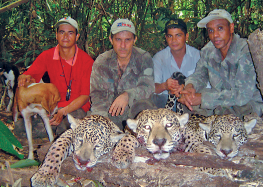 Temístocles Barbosa Freire (second from left) and other alleged members of a poaching ring pose with dead jaguars in photo federal police copied from a confiscated cell phone.